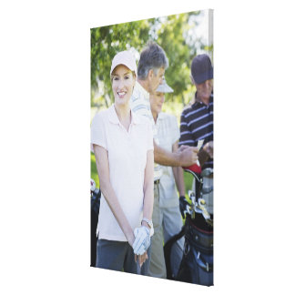 Couples preparing to play golf gallery wrap canvas