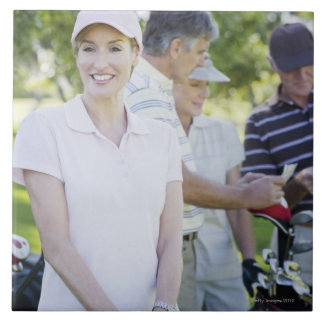 Couples preparing to play golf tile