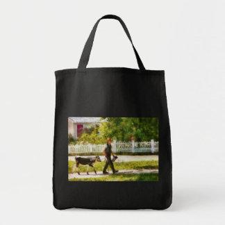 Cow - Bringing home Bessie Tote Bags