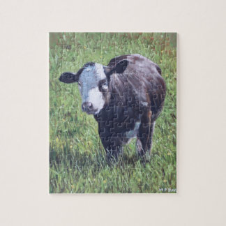 Cow in grass jigsaw puzzle
