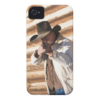 Cowboy aiming his gun, standing by an old log Case-Mate iPhone 4 case
