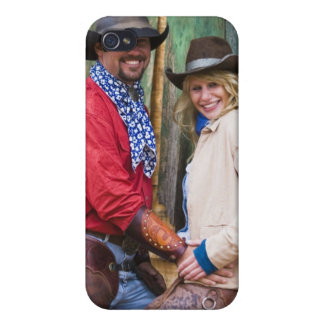 Cowboy and cowgirl holding hands in front of an iPhone 4 case