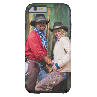 Cowboy and cowgirl holding hands in front of an tough iPhone 6 case