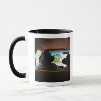 Cowboy and cowgirl in truck mug