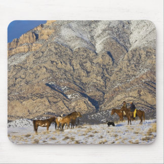 Cowboy and Cowgirl on Horses watching Herd Mouse Pad