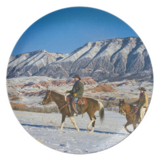 Cowboy and Cowgirl riding Horse through the Snow Dinner Plates