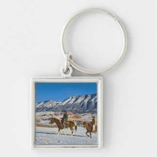 Cowboy and Cowgirl riding Horse through the Snow Silver-Colored Square Key Ring