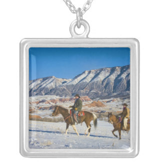 Cowboy and Cowgirl riding Horse through the Snow Silver Plated Necklace