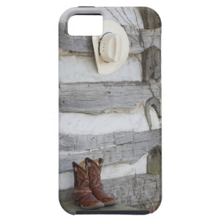 Cowboy boots and hat outside of log cabin iPhone 5 cover