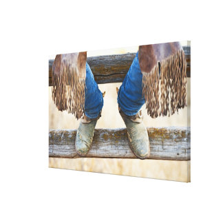 Cowboy boots on fence canvas print