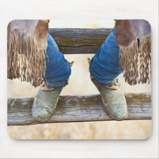 Cowboy boots on fence mouse mat