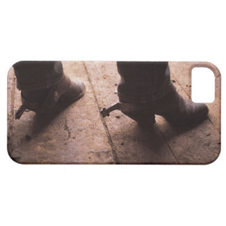 Cowboy boots with spurs on boardwalk at iPhone 5 cover