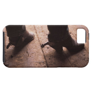 Cowboy boots with spurs on boardwalk at iPhone 5 covers