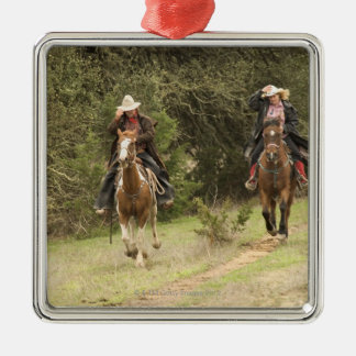 Cowboy couple riding horses christmas ornament