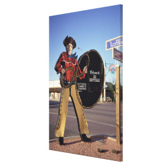 Cowboy figure sign welcoming tourists to Scottsdal Canvas Print