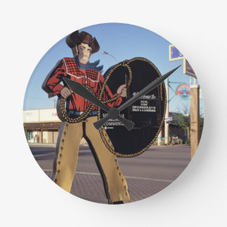 Cowboy figure sign welcoming tourists to Scottsdal Round Clock