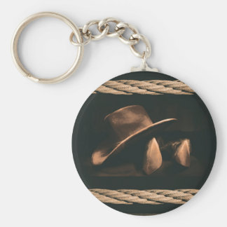 Cowboy hat, boots and rope western style masculine key ring
