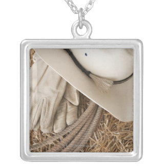 Cowboy hat gloves and rope on haystack silver plated necklace