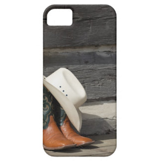 Cowboy hat on cowboy boots outside a log cabin iPhone 5 cases