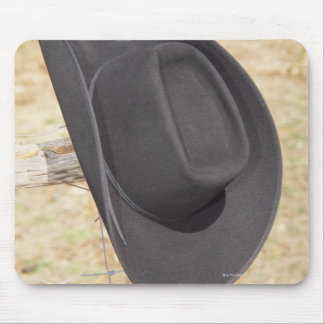 Cowboy hat on fence mouse mat