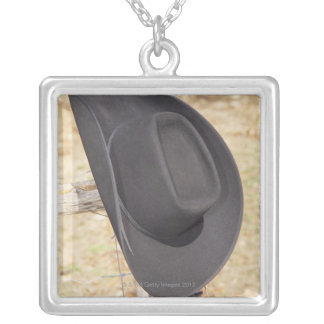 Cowboy hat on fence silver plated necklace