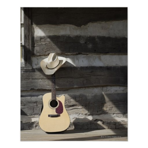 Cowboy hat on guitar leaning on log cabin print