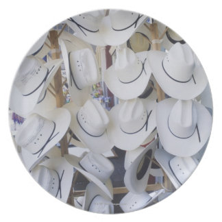 Cowboy hats hanging in a hat shop, Texas, USA Plate