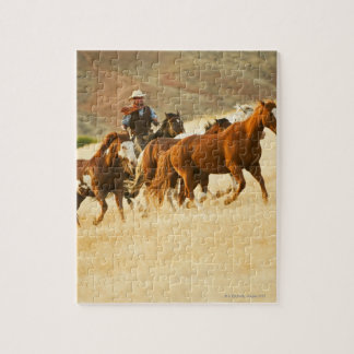 Cowboy herding horses 3 puzzle