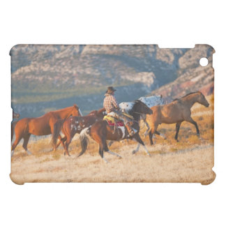 Cowboy herding wild horses 2 cover for the iPad mini