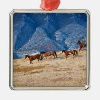 Cowboy herding wild horses Silver-Colored square decoration