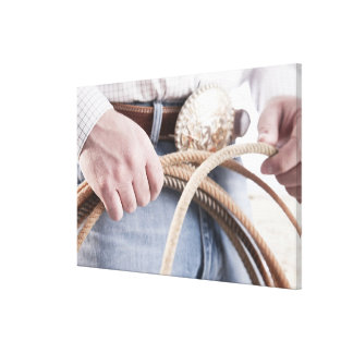 Cowboy holding a rope canvas print