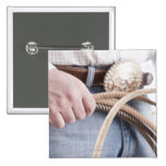 Cowboy holding a rope pinback button