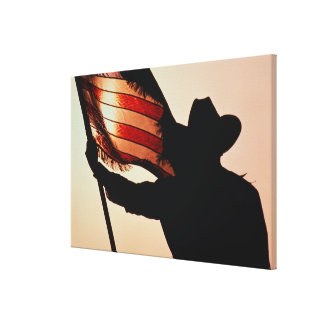 Cowboy holding Stars and Stripes, silhouette, Canvas Print