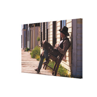 Cowboy in chair on boardwalk in South Park City, Canvas Print