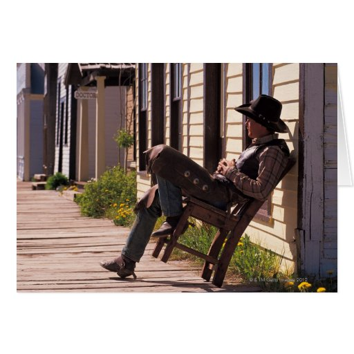Cowboy in chair on boardwalk in South Park City, Card