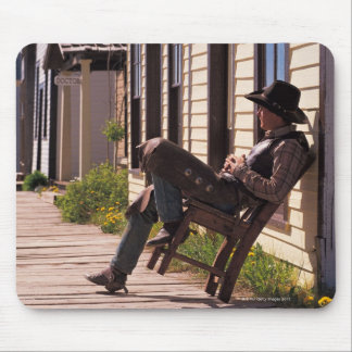 Cowboy in chair on boardwalk in South Park City, Mouse Mat