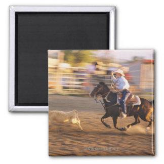 Cowboy lassoing calf magnet