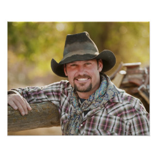 Cowboy leaning on fence poster