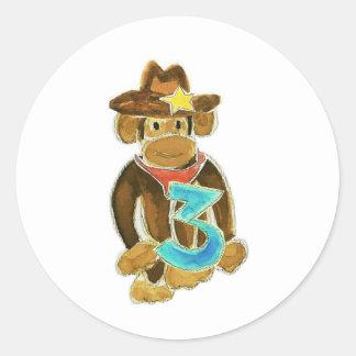 Cowboy Monkey Holding Three Round Sticker