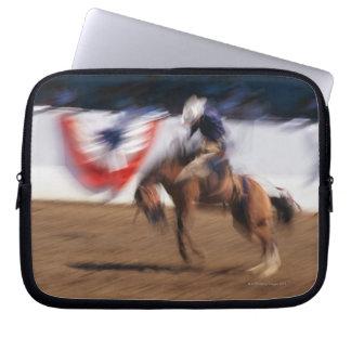 Cowboy on bucking bronco laptop sleeve