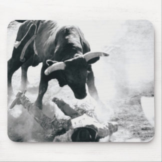 Cowboy on ground after falling off bull mouse mat
