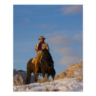 Cowboy on his Horse in the Snow Poster