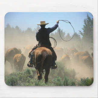Cowboy on horse with lasso driving cattle mouse pad