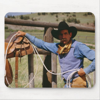Cowboy posing with lasso and pet dog mouse mat