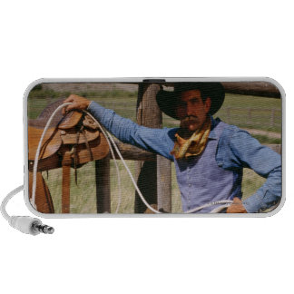 Cowboy posing with lasso and pet dog notebook speakers