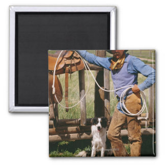 Cowboy posing with lasso and pet dog square magnet
