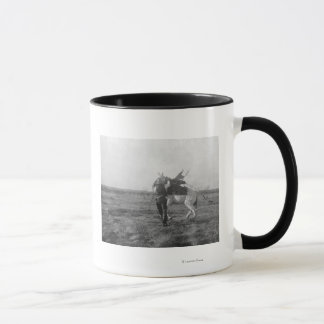 "Cowboy ""Red Saunders"" Saddles a Bronco Mug"