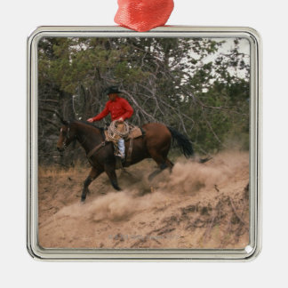 Cowboy riding downhill christmas ornament