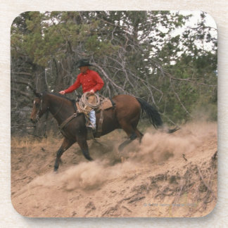Cowboy riding downhill drink coaster
