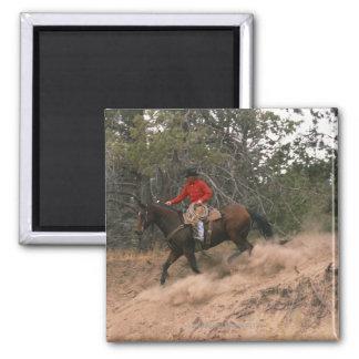 Cowboy riding downhill magnet